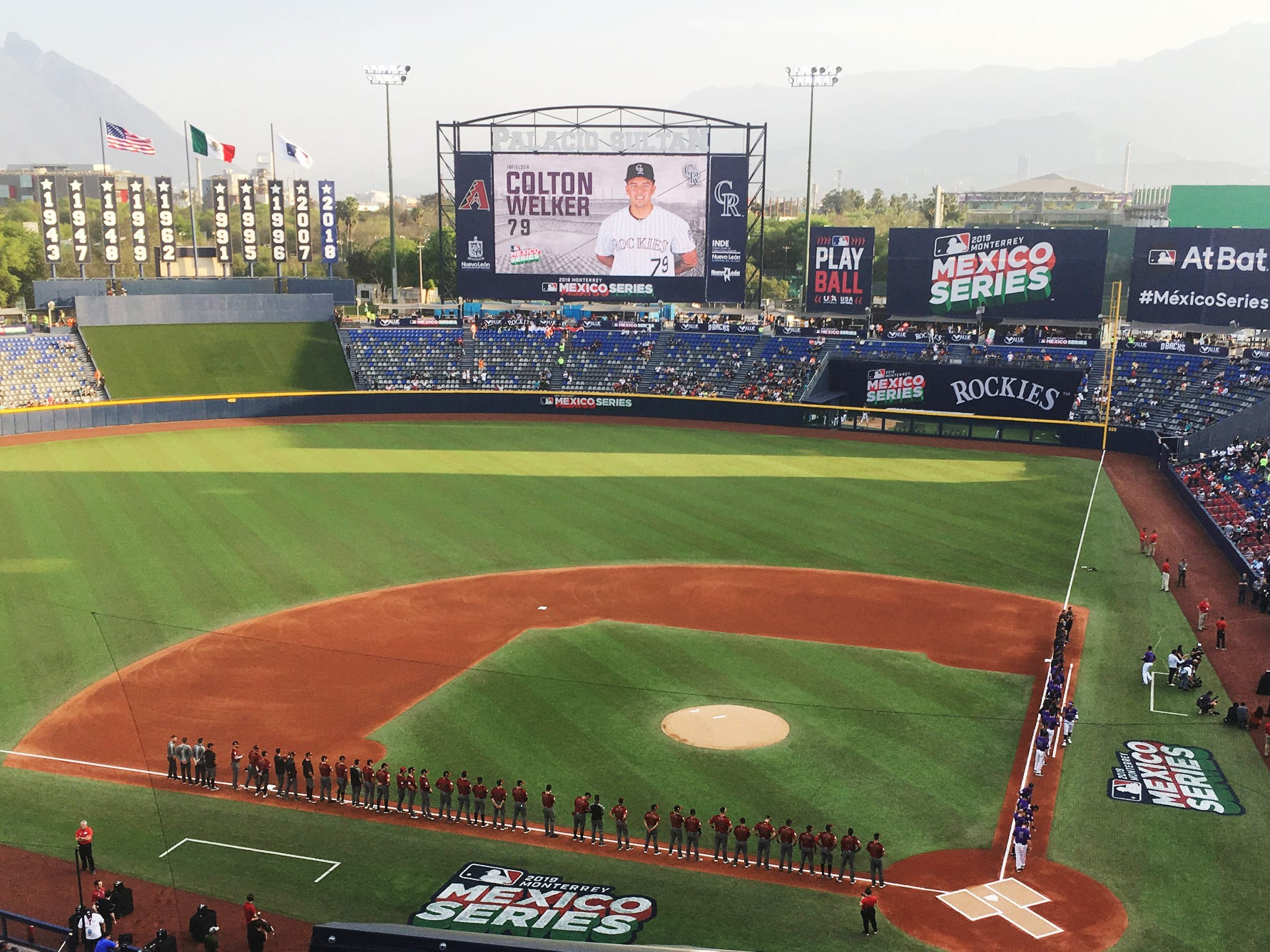 The Arizona Diamondbacks and the Colorado Rockies lined up before playing one of two spring training games in Monterrey, Mexico.