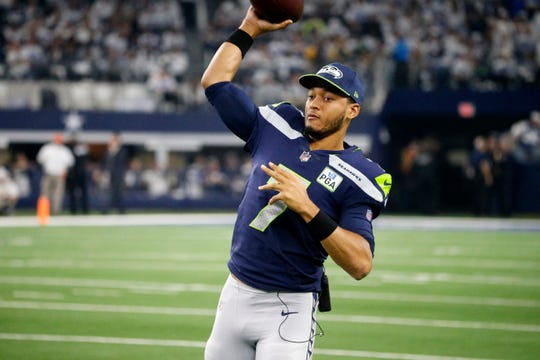Seattle Seahawks quarterback Brett Hundley (7) throws a pass during warm ups before an NFC wild-card NFL football game against the Dallas Cowboys in Arlington, Texas, Saturday, Jan. 5, 2019.