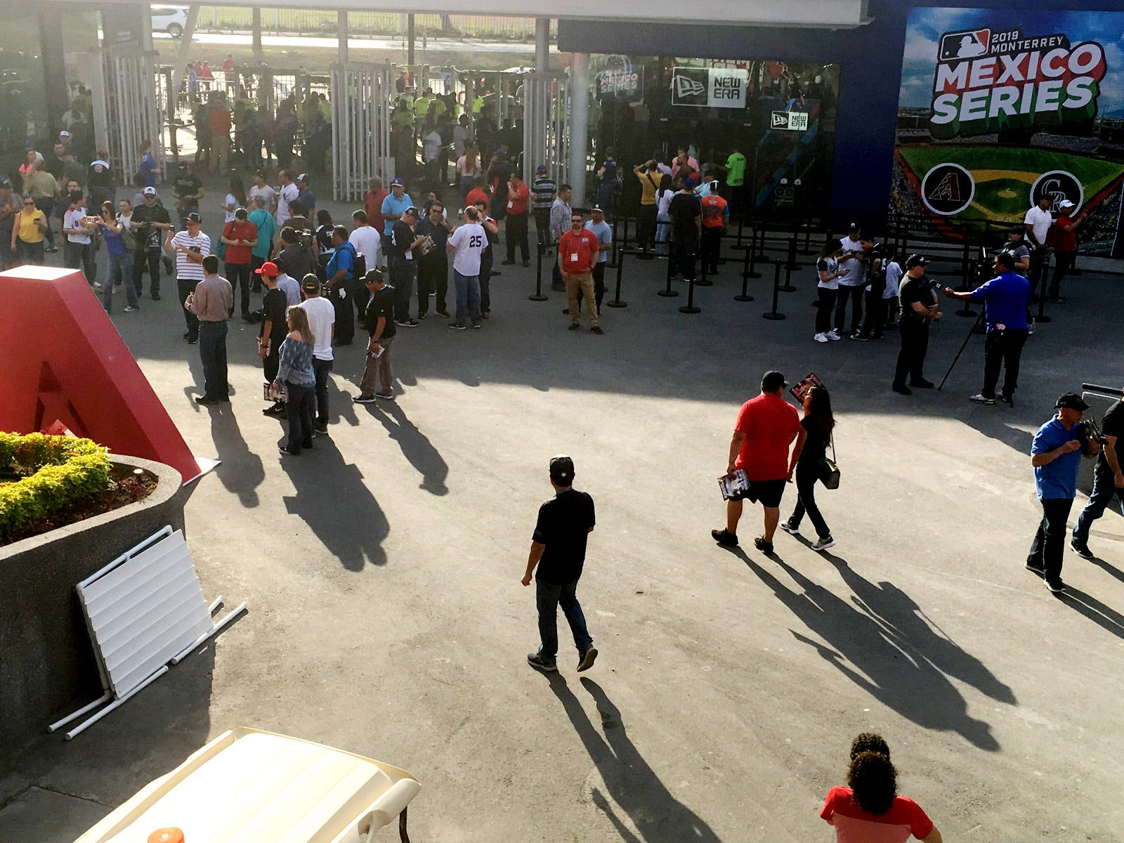 Fans stream into the baseball stadium in Monterrey, Mexico, to watch a spring training game between the Arizona Diamondbacks and the Colorado Rockies.