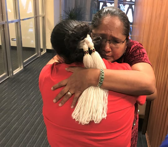 Debbie Nez Manuel hugs her daughter in tears after HB2570 passed the House of Representative with a 60-0 vote on Monday, March 11, 2019.