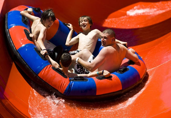 Thrill seekers slide down a river ride at Six Flags Hurricane Harbor.