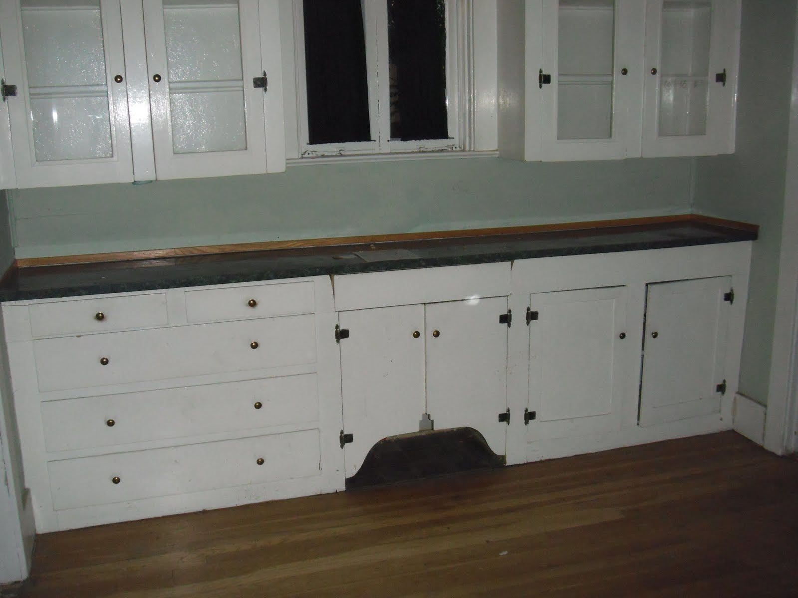 2010 picture of original kitchen cabinets, an area that is now a dining room.