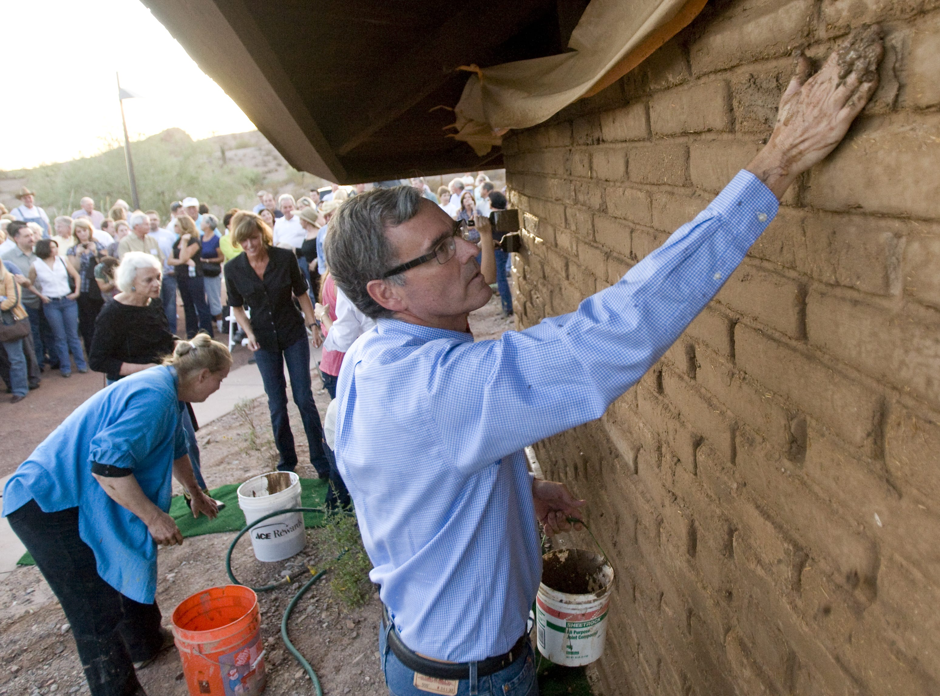 John O'Connor, Sandra Day O'Connor's son, puts mud on the O'Connor House at Papago Park in Tempe on Oct. 18, 2009.