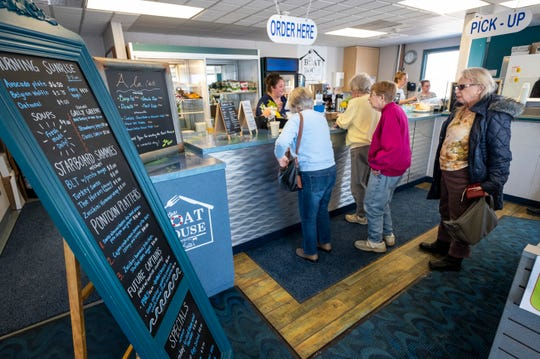 Guests line up to order lunch Tuesday, March 12, 2019 at the Boat House by Kate's, which opened several days ago inside the Maritime Center in Port Huron.