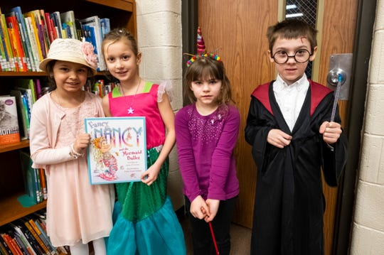 On Tuesday, March 12, 2019, students and faculty at Literacy Academy at Cleveland were encouraged to dress up as their favorite book characters to celebrate Reading Month. From left: Rylee Lerma, 6 and Theryn Snyder, 6, both dressed as Fancy Nancy, while Maria LeCluyse, 6, dressed as a unicorn and Ezio Guiliano, 7, dressed as Harry Potter.