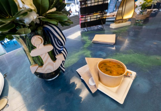 "A bowl of the Boat House by Kate's ""In The Navy"" soup sits on the counter inside the restaurant, which recently opened in the Maritime Center in Port Huron. The soup, which is the restaurant's new house soup, has potato, spinach, bacon and navy beans."