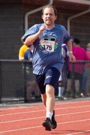 Billy Seide, a Hudson Valley athlete, runs track at a preview Special Olympics Summer Games.