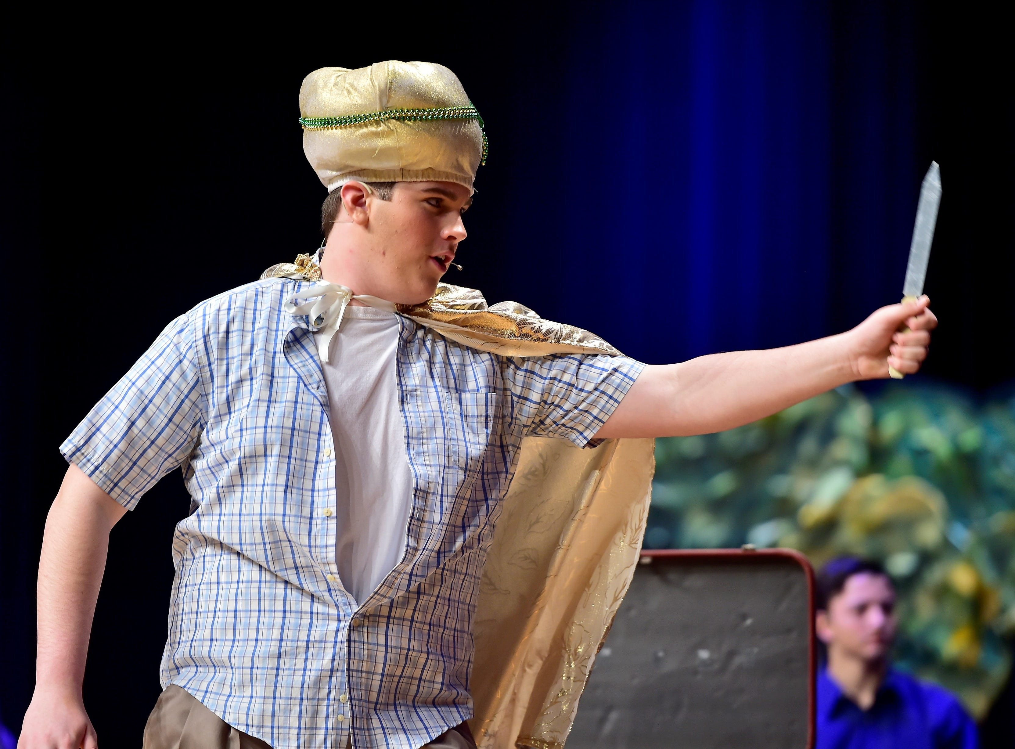 """Mason Swankler's Hines swaps his pajama-factory supervisor duties for being a knife-throwing showman, during a scene  from """"The Pajama Game,"""" on Sunday, March 10, 2019, at Waynesboro Area Senior High School. The musical, based on the 1953 novel, """"7 1/2 Cents"""" by Richard Bissell, tells the story of a pajama factory where workers are fighting for a raise of 7 1/2 cents. Showtimes for Waynesboro Area School District's All-School Production of """"The Pajama Game"""" are 7 p.m. Friday and Saturday, March 15 and 16, and 2 p.m. Sunday, March 17 in the high school auditorium. For choose-your-seat tickets, $10 for adults and $6 for children under 12, go to https://washsmusic.ticketleap.com/the-pajama-game/. General admission tickets will also be sold at the door."""