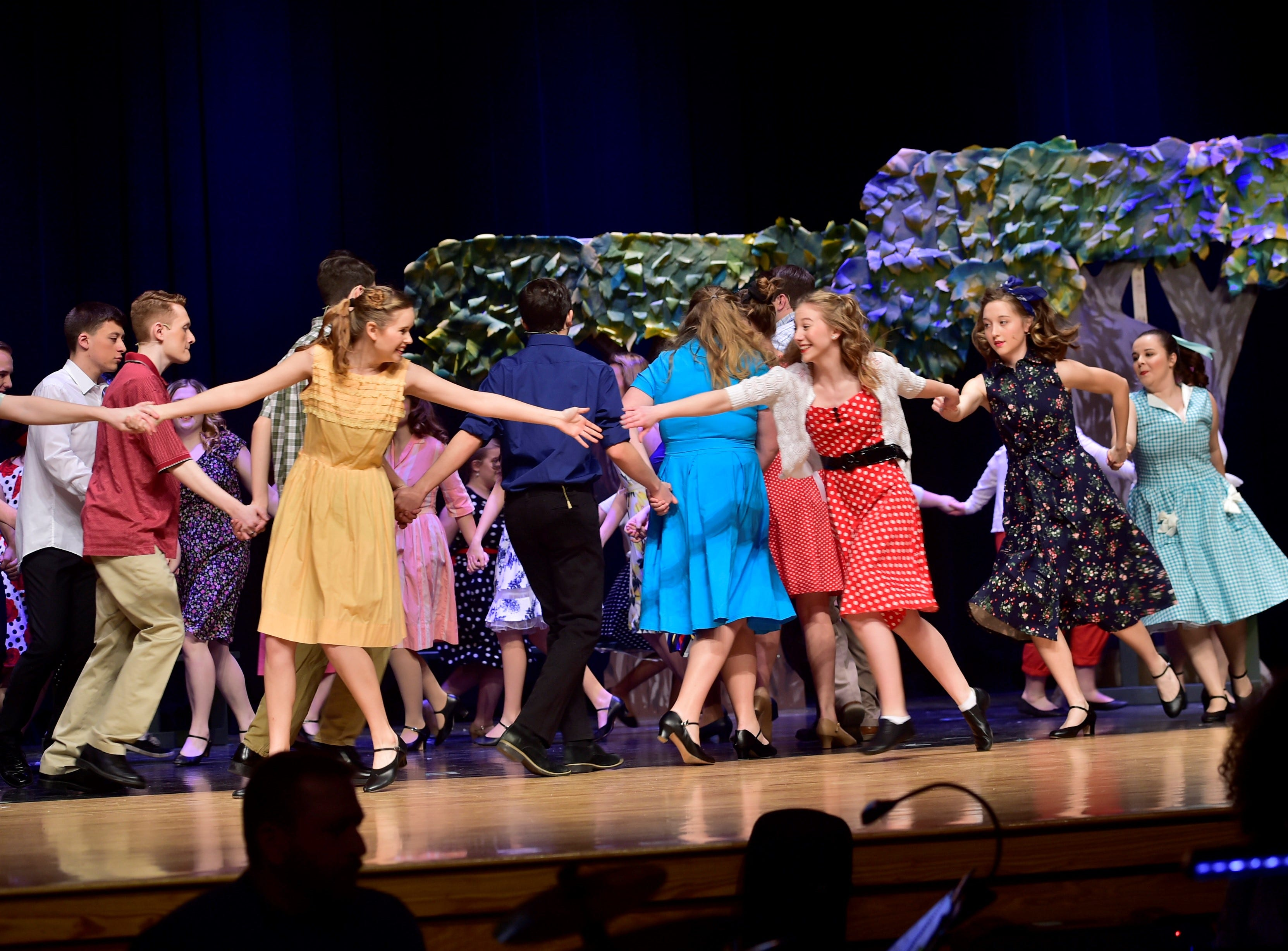 """Cast members rehearse a dance number in a scene  from """"The Pajama Game,"""" on Sunday, March 10, 2019, at Waynesboro Area Senior High School. The musical, based on the 1953 novel, """"7 1/2 Cents"""" by Richard Bissell, tells the story of a pajama factory where workers are fighting for a raise of 7 1/2 cents. Showtimes for Waynesboro Area School District's All-School Production of """"The Pajama Game"""" are 7 p.m. Friday and Saturday, March 15 and 16, and 2 p.m. Sunday, March 17 in the high school auditorium. For choose-your-seat tickets, $10 for adults and $6 for children under 12, go to https://washsmusic.ticketleap.com/the-pajama-game/. General admission tickets will also be sold at the door."""