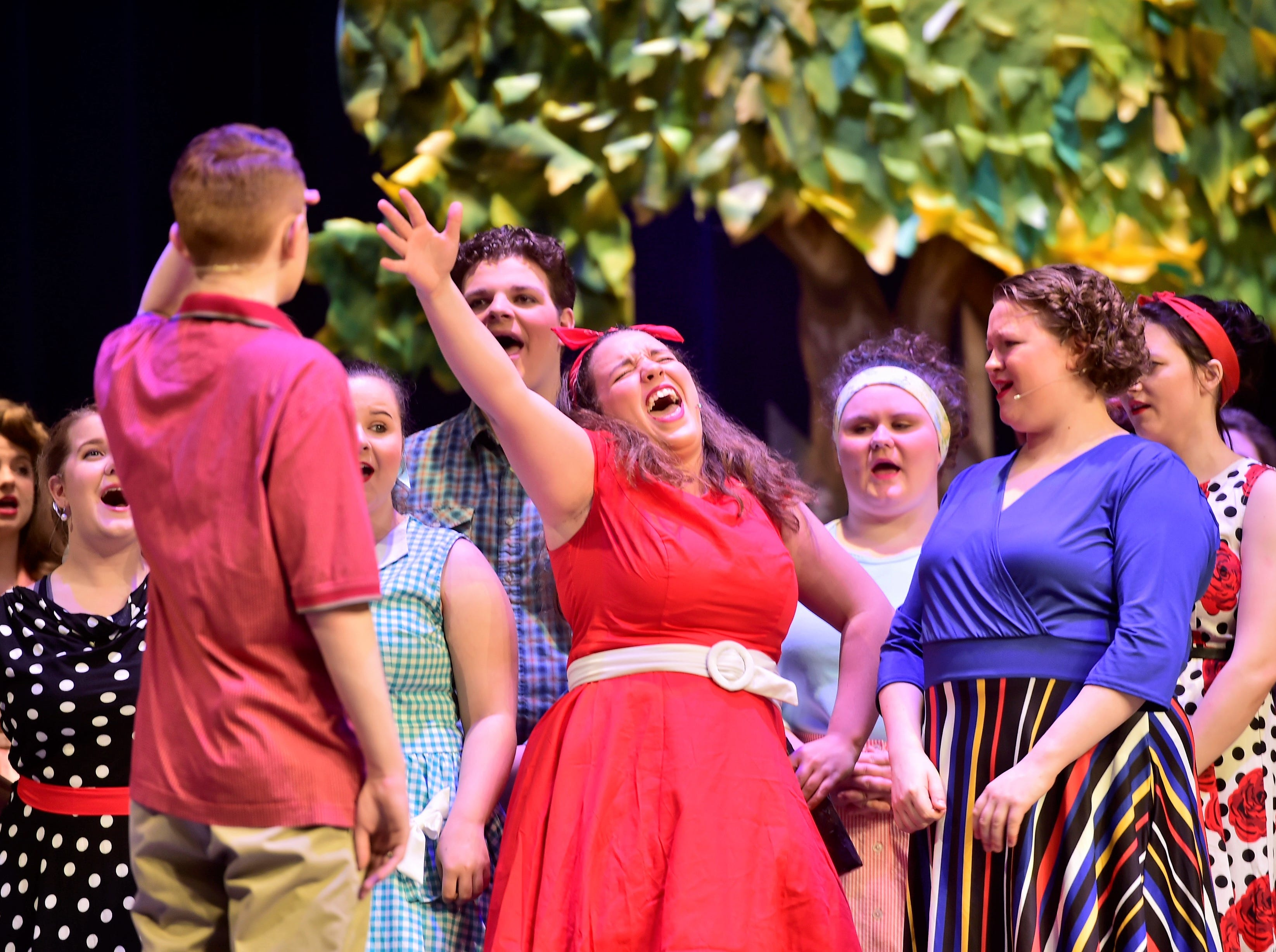 """Olivia Policicchio (Brenda), center, sings while rehearsing a scene  from """"The Pajama Game,"""" on Sunday, March 10, 2019, at Waynesboro Area Senior High School. The musical, based on the 1953 novel, """"7 1/2 Cents"""" by Richard Bissell, tells the story of a pajama factory where workers are fighting for a raise of 7 1/2 cents. Showtimes for Waynesboro Area School District's All-School Production of """"The Pajama Game"""" are 7 p.m. Friday and Saturday, March 15 and 16, and 2 p.m. Sunday, March 17 in the high school auditorium. For choose-your-seat tickets, $10 for adults and $6 for children under 12, go to https://washsmusic.ticketleap.com/the-pajama-game/. General admission tickets will also be sold at the door."""