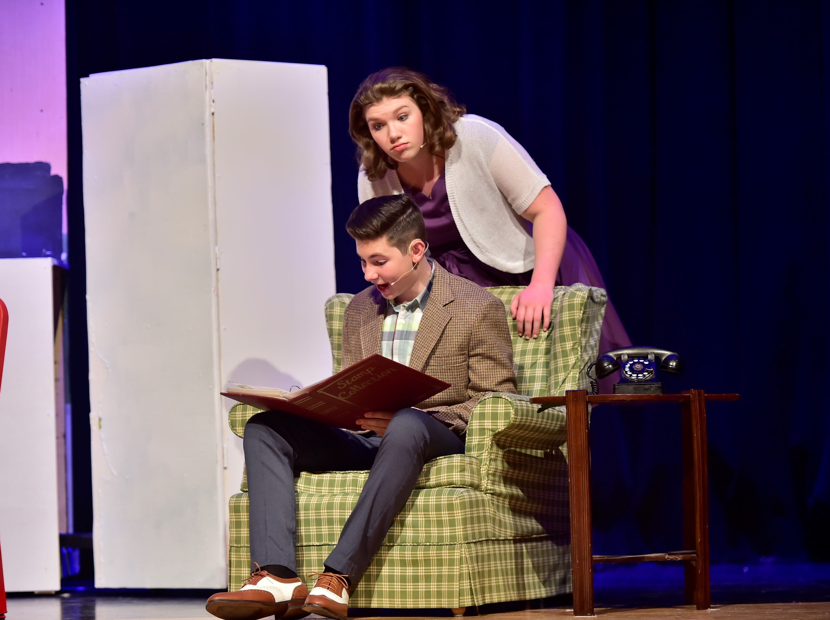 """Jude Musolino (Sid Sorokin), sitting, and Taylor Stevens (Babe) rehearse a scene  from """"The Pajama Game,"""" on Sunday, March 10, 2019, at Waynesboro Area Senior High School. The musical, based on the 1953 novel, """"7 1/2 Cents"""" by Richard Bissell, tells the story of a pajama factory where workers are fighting for a raise of 7 1/2 cents. Showtimes for Waynesboro Area School District's All-School Production of """"The Pajama Game"""" are 7 p.m. Friday and Saturday, March 15 and 16, and 2 p.m. Sunday, March 17 in the high school auditorium. For choose-your-seat tickets, $10 for adults and $6 for children under 12, go to https://washsmusic.ticketleap.com/the-pajama-game/. General admission tickets will also be sold at the door."""
