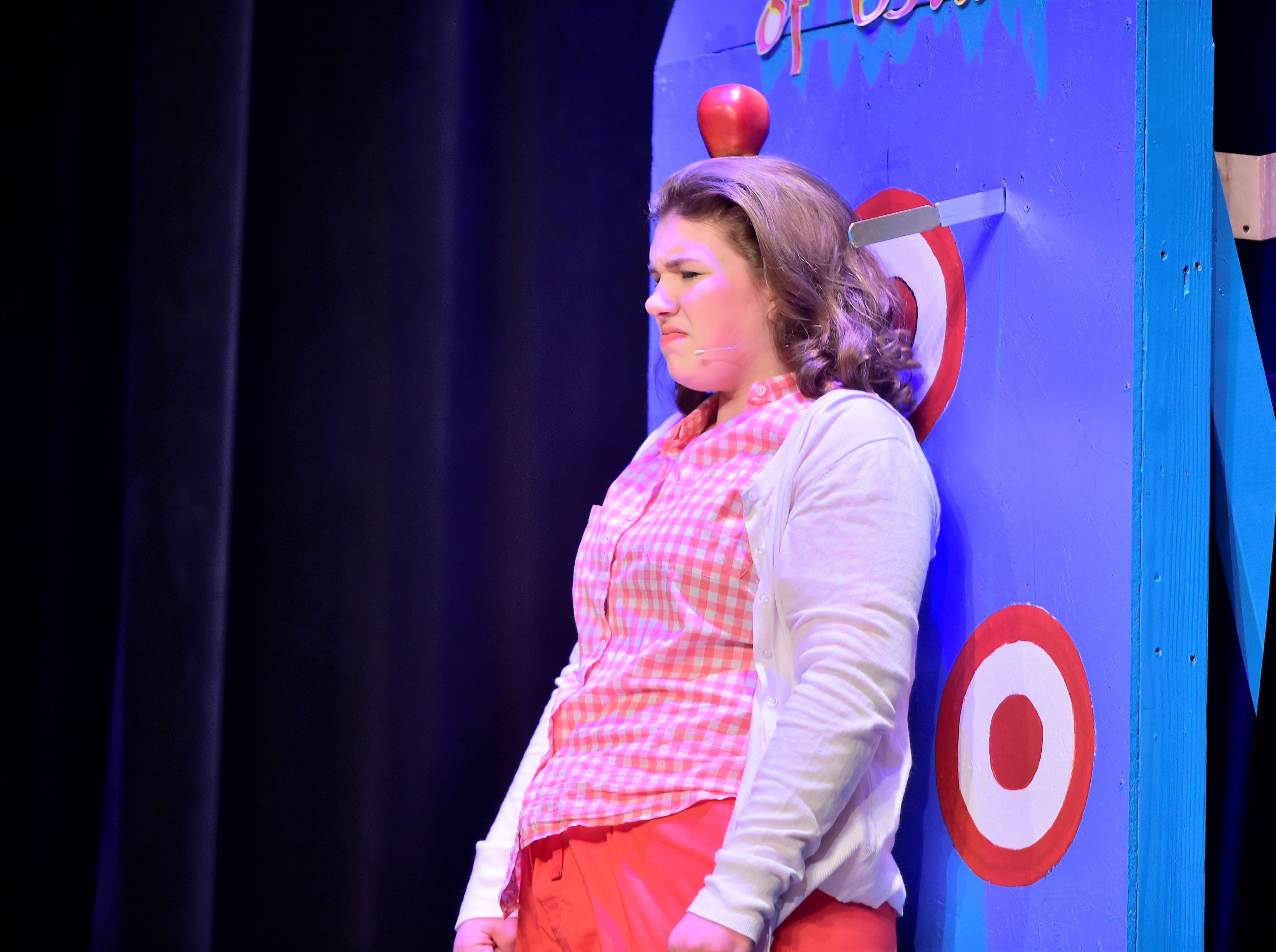 """Taylor Stevens, as Babe, tenses as the not-pictured Hines, played by Mason Swankler, throws knives toward her in a scene from """"The Pajama Game,"""" on Sunday, March 10, 2019, at Waynesboro Area Senior High School. The musical, based on the 1953 novel, """"7 1/2 Cents"""" by Richard Bissell, tells the story of a pajama factory where workers are fighting for a raise of 7 1/2 cents. Showtimes for Waynesboro Area School District's All-School Production of """"The Pajama Game"""" are 7 p.m. Friday and Saturday, March 15 and 16, and 2 p.m. Sunday, March 17 in the high school auditorium. For choose-your-seat tickets, $10 for adults and $6 for children under 12, go to https://washsmusic.ticketleap.com/the-pajama-game/. General admission tickets will also be sold at the door."""
