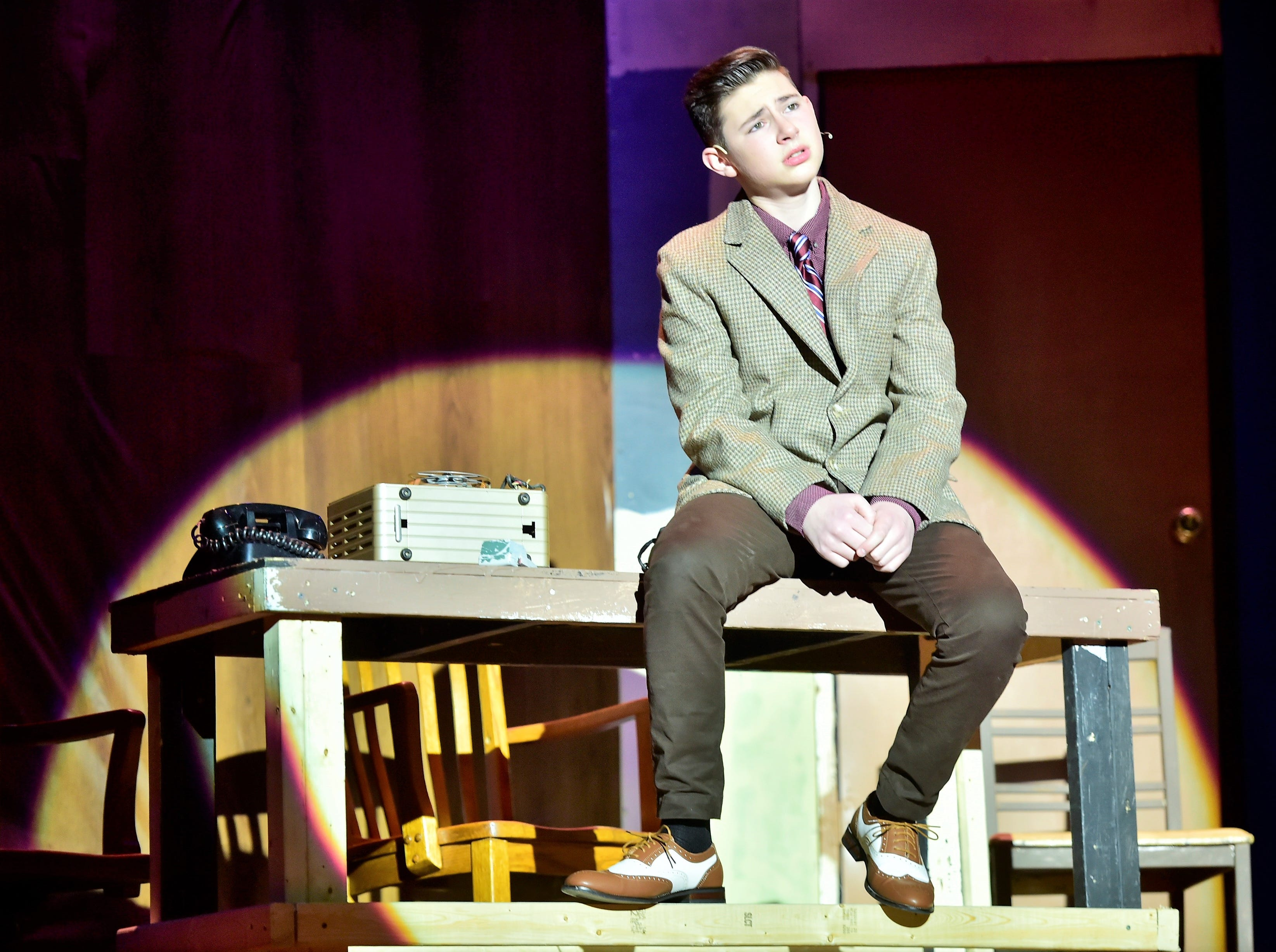 """Jude Musolino, as Sid Sorokin, rehearses a solo musical number  from """"The Pajama Game,"""" on Sunday, March 10, 2019, at Waynesboro Area Senior High School. The musical, based on the 1953 novel, """"7 1/2 Cents"""" by Richard Bissell, tells the story of a pajama factory where workers are fighting for a raise of 7 1/2 cents. Showtimes for Waynesboro Area School District's All-School Production of """"The Pajama Game"""" are 7 p.m. Friday and Saturday, March 15 and 16, and 2 p.m. Sunday, March 17 in the high school auditorium. For choose-your-seat tickets, $10 for adults and $6 for children under 12, go to https://washsmusic.ticketleap.com/the-pajama-game/. General admission tickets will also be sold at the door."""