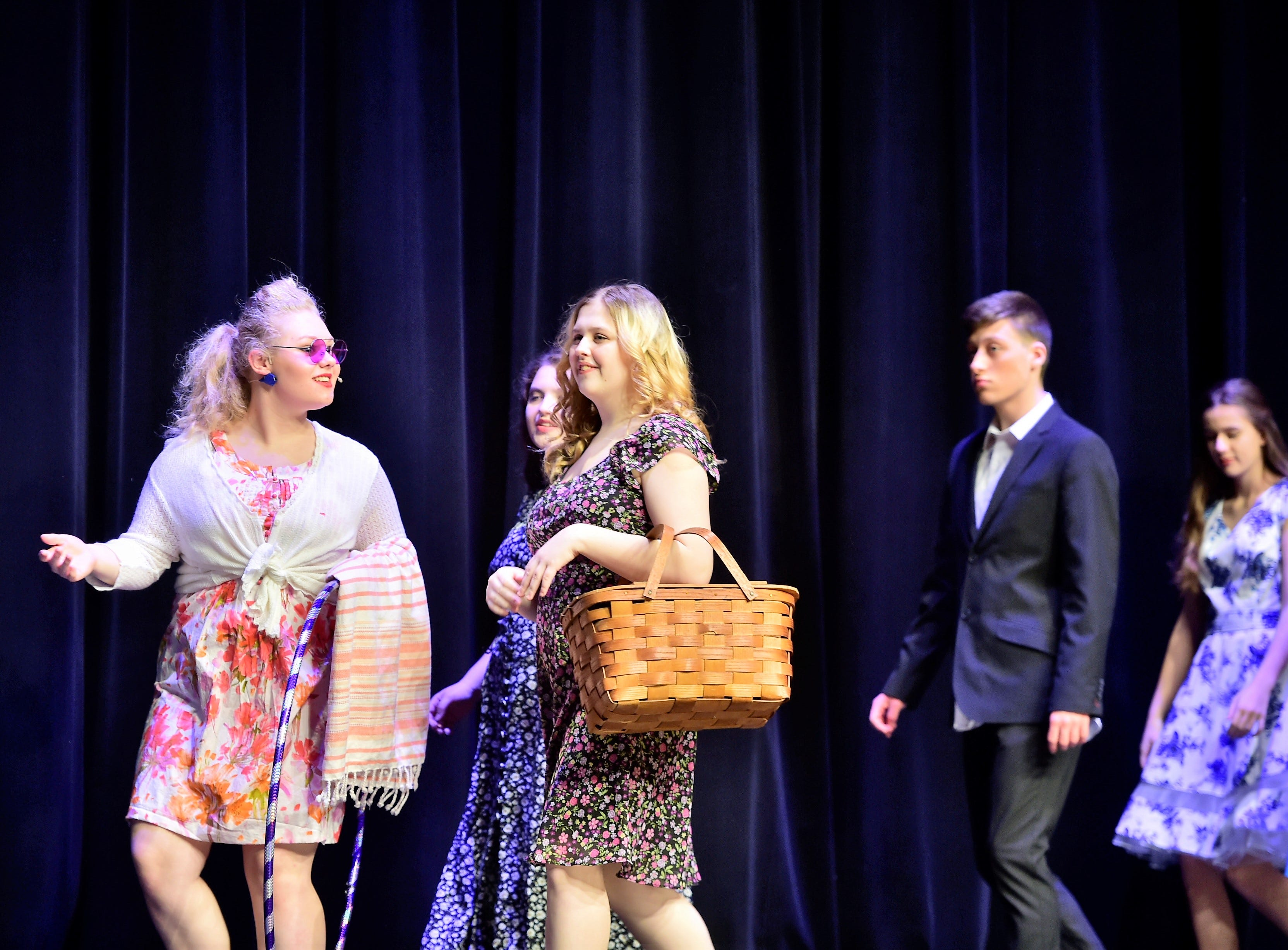 """Cast members walk across the stage while rehearsing a scene from """"The Pajama Game,"""" on Sunday, March 10, 2019, at Waynesboro Area Senior High School. The musical, based on the 1953 novel, """"7 1/2 Cents"""" by Richard Bissell, tells the story of a pajama factory where workers are fighting for a raise of 7 1/2 cents. Showtimes for Waynesboro Area School District's All-School Production of """"The Pajama Game"""" are 7 p.m. Friday and Saturday, March 15 and 16, and 2 p.m. Sunday, March 17 in the high school auditorium. For choose-your-seat tickets, $10 for adults and $6 for children under 12, go to https://washsmusic.ticketleap.com/the-pajama-game/. General admission tickets will also be sold at the door."""