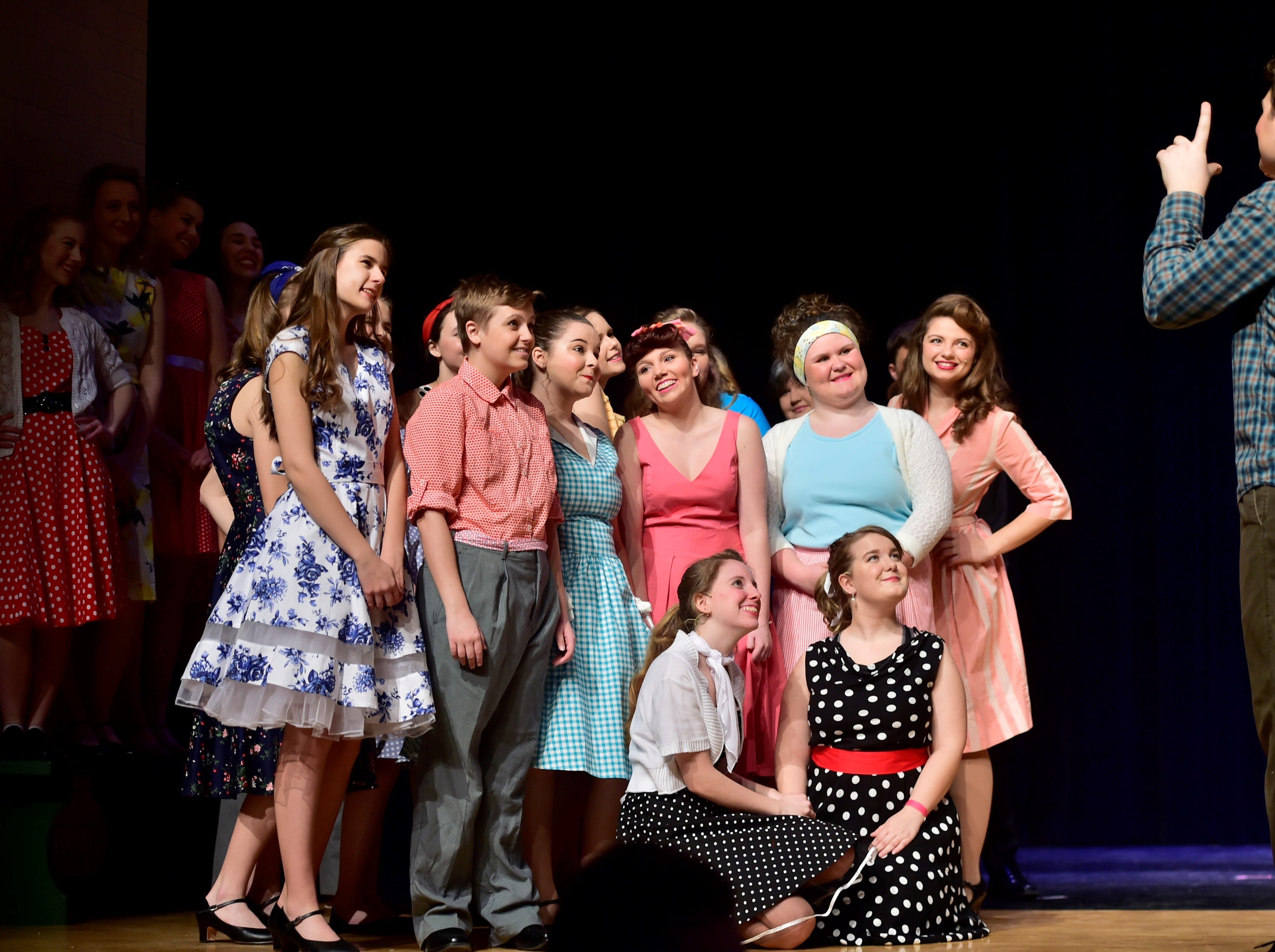 """Cast members pose while a fellow character takes a photo of the group during a scene  from """"The Pajama Game,"""" on Sunday, March 10, 2019, at Waynesboro Area Senior High School. The musical, based on the 1953 novel, """"7 1/2 Cents"""" by Richard Bissell, tells the story of a pajama factory where workers are fighting for a raise of 7 1/2 cents. Showtimes for Waynesboro Area School District's All-School Production of """"The Pajama Game"""" are 7 p.m. Friday and Saturday, March 15 and 16, and 2 p.m. Sunday, March 17 in the high school auditorium. For choose-your-seat tickets, $10 for adults and $6 for children under 12, go to https://washsmusic.ticketleap.com/the-pajama-game/. General admission tickets will also be sold at the door."""