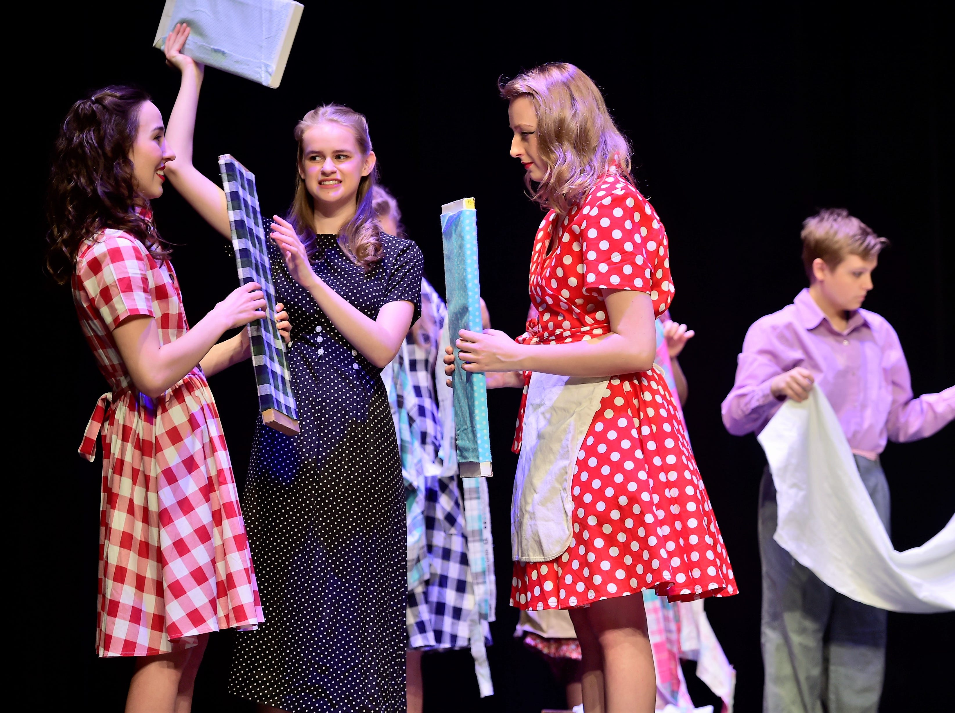 """Teens portraying pajama factory workers rehearse a scene  from """"The Pajama Game,"""" on Sunday, March 10, 2019, at Waynesboro Area Senior High School. The musical, based on the 1953 novel, """"7 1/2 Cents"""" by Richard Bissell, tells the story of a pajama factory where workers are fighting for a raise of 7 1/2 cents. Showtimes for Waynesboro Area School District's All-School Production of """"The Pajama Game"""" are 7 p.m. Friday and Saturday, March 15 and 16, and 2 p.m. Sunday, March 17 in the high school auditorium. For choose-your-seat tickets, $10 for adults and $6 for children under 12, go to https://washsmusic.ticketleap.com/the-pajama-game/. General admission tickets will also be sold at the door."""
