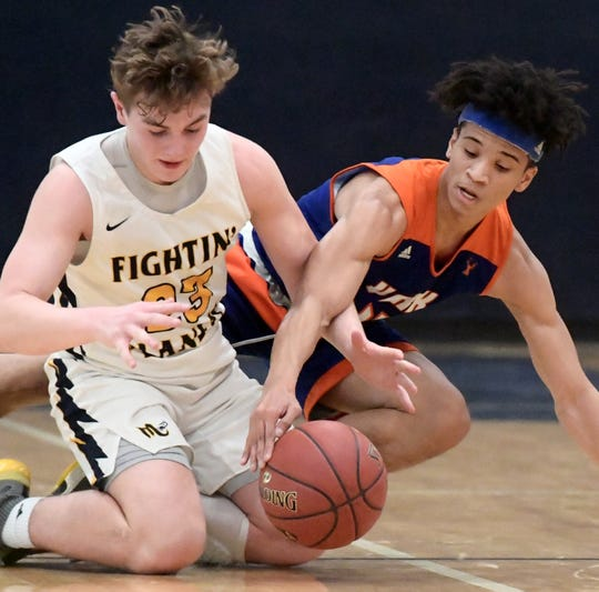 York High's Jaevon Woodyard and Mars' Brandon Caruso battle for a loose ball during a PIAA Class 5-A second-round state boys' basketball playoff game at Holidaysburg High School in Blair County Tuesday, March 12, 2019. York lost 60-59. Bill Kalina photo