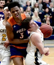 York High's Clovis Gallon Jr. commits a foul driving past  Mars' Zach Schlegel during a PIAA Class 5-A second-round state boys' basketball playoff game at Holidaysburg High School in Blair County Tuesday, March 12, 2019. Bill Kalina photo