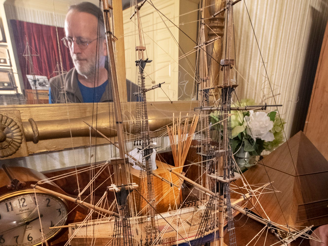 Dennis Kinkle stands with the two ships made by Roland Whitmire in the 1970s at his home on West Philadelphia Street in York. Kunkle, who has owned the home for 15 years, recently bought them back at an auction and plans on cleaning and displaying them again in the home.