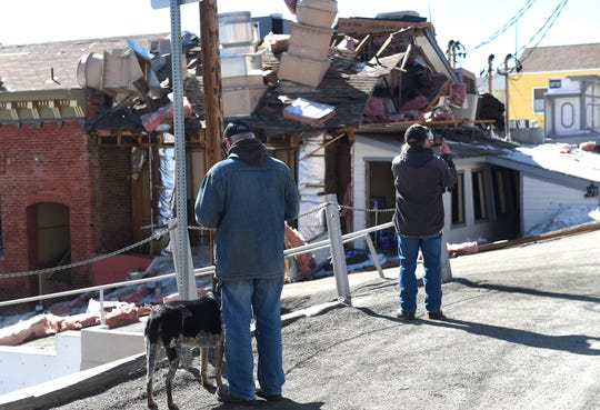Local residents inspect the aftermath of an explosion at the historic Delta Saloon in Virginia City on March 12, 2019. One person inside the building at the time of the explosion was not hurt.