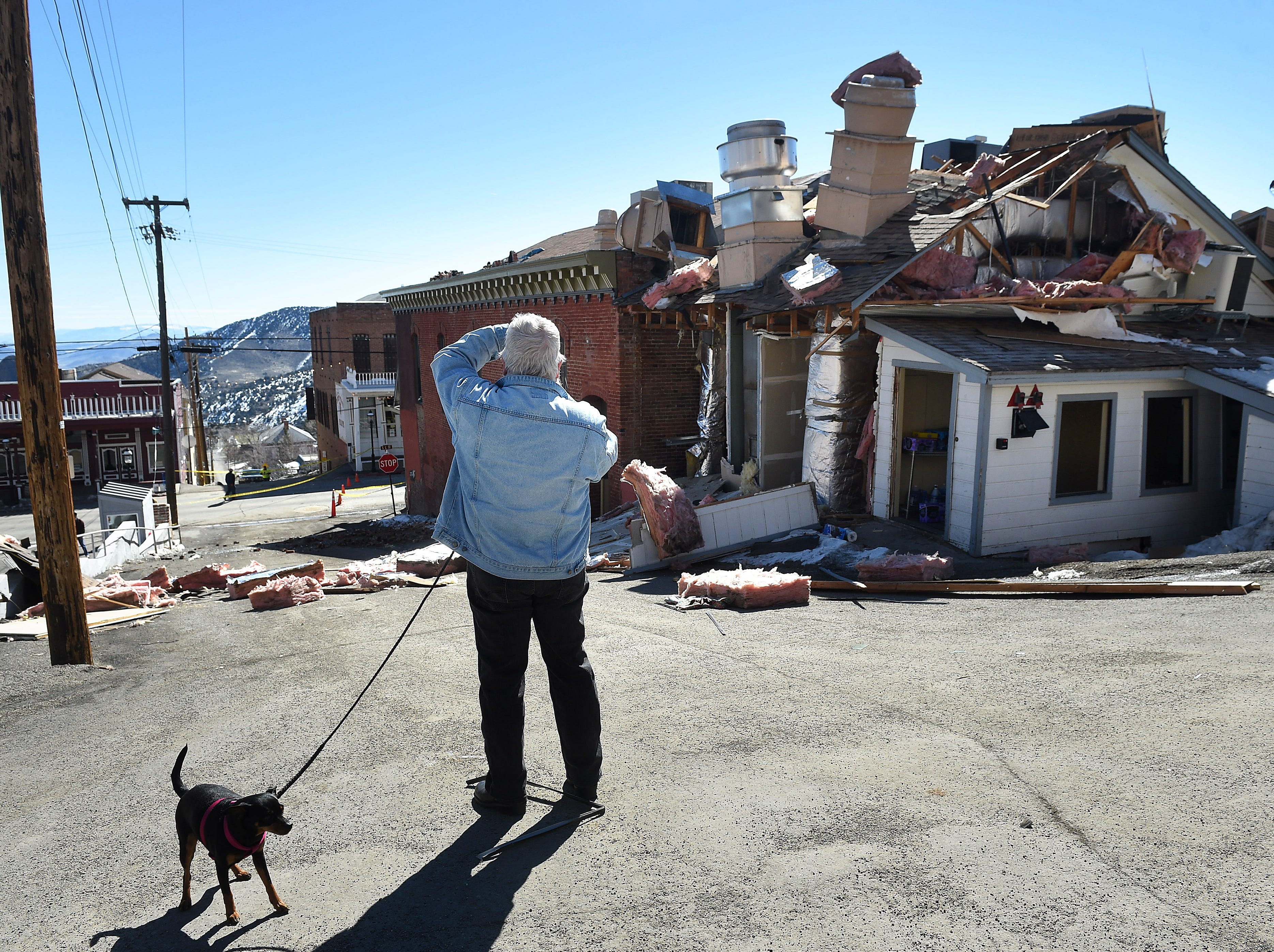A local resident inspects the aftermath of an explosion at the historic Delta Saloon in Virginia City on March 12, 2019. One employee was in the building at the time of the explosion was not hurt.