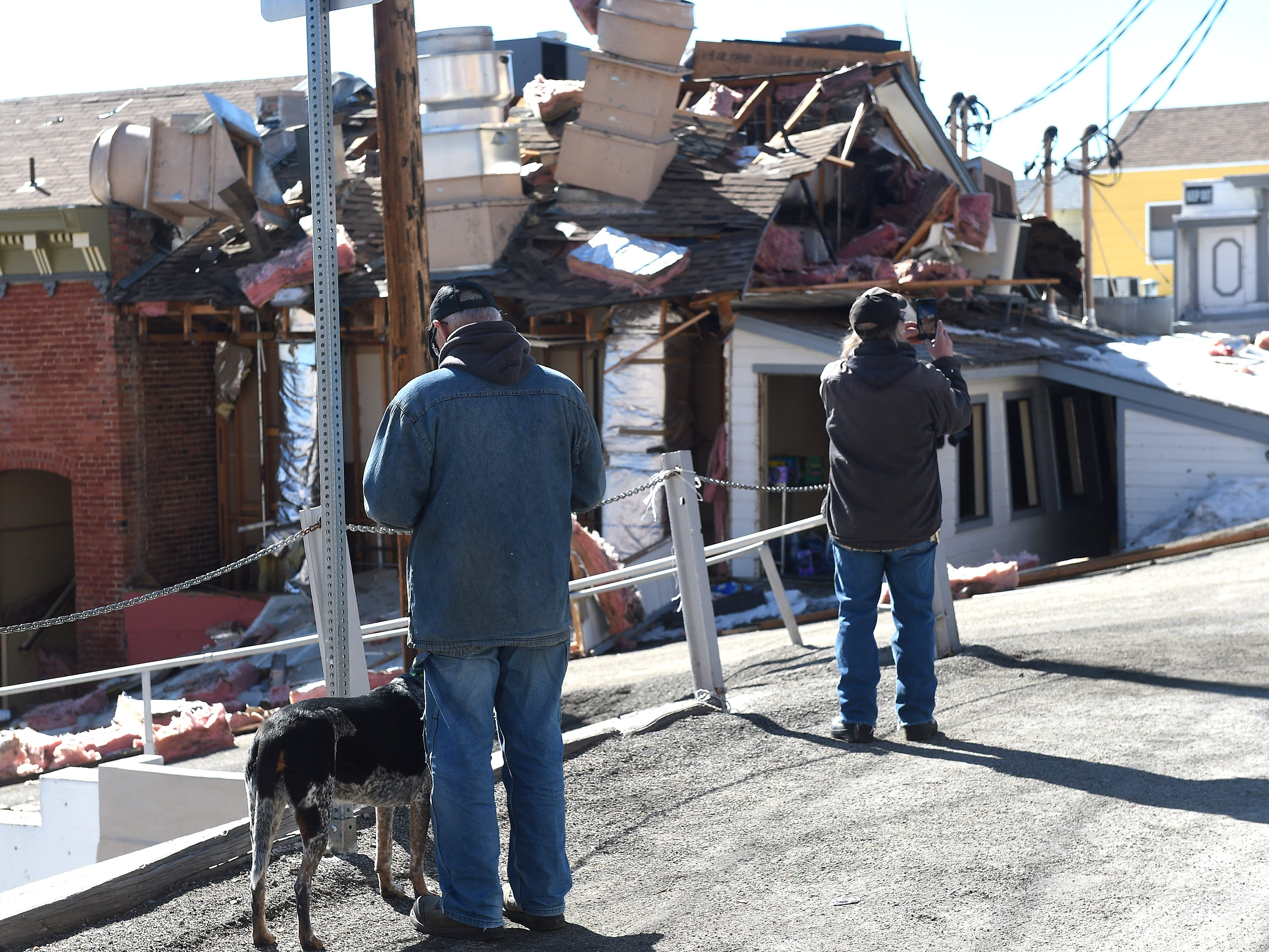 Local residents inspect the aftermath of an explosion at the historic Delta Saloon in Virginia City on March 12, 2019. One employee was in the building at the time of the explosion was not hurt.