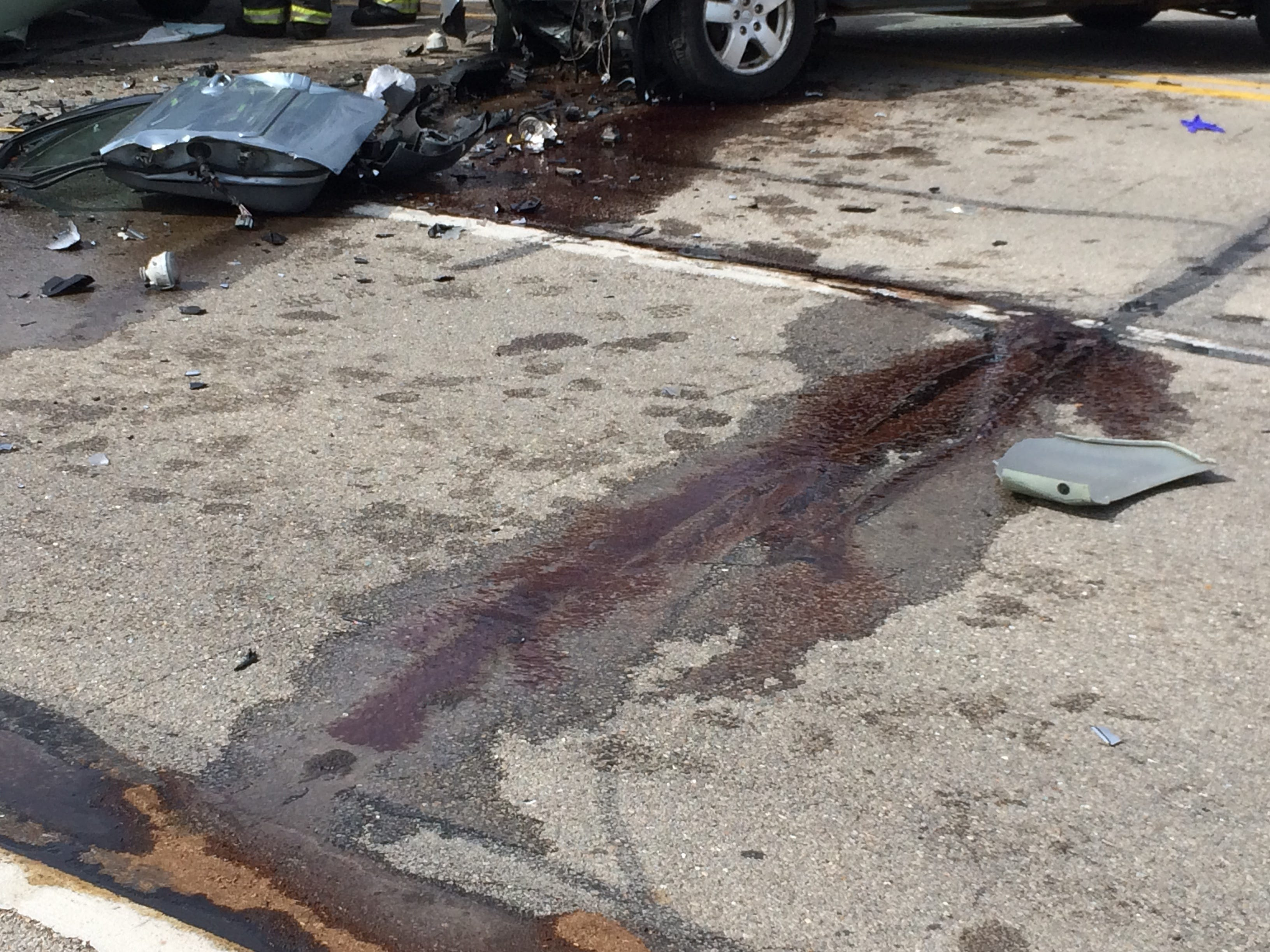 Fluids and debris littered National Road West's eastbound lanes Tuesday afternoon after an accident in the 3900 block.