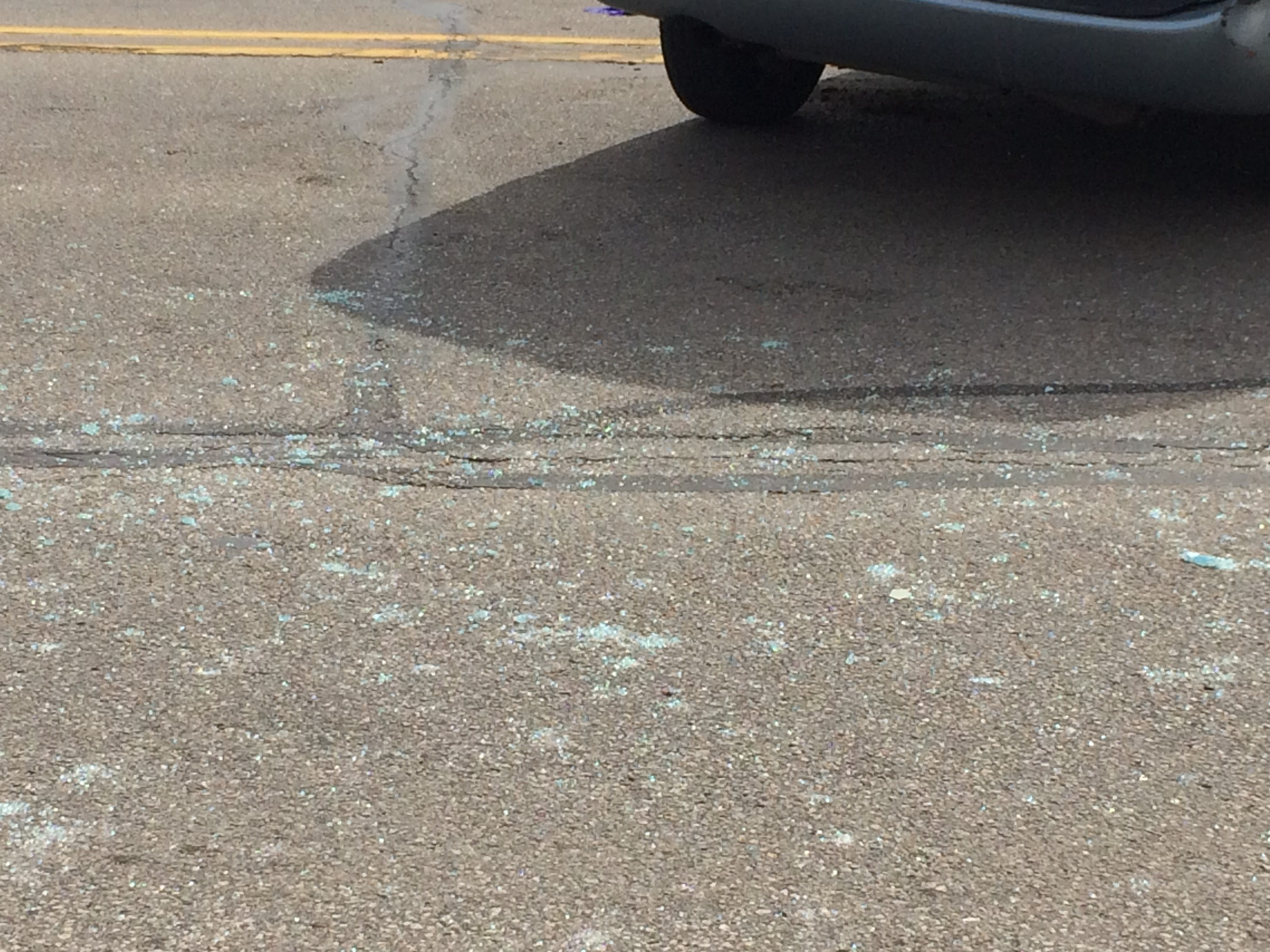 Broken glass littered the westbound lanes of National Road West on Tuesday after an accident in the 3900 block.
