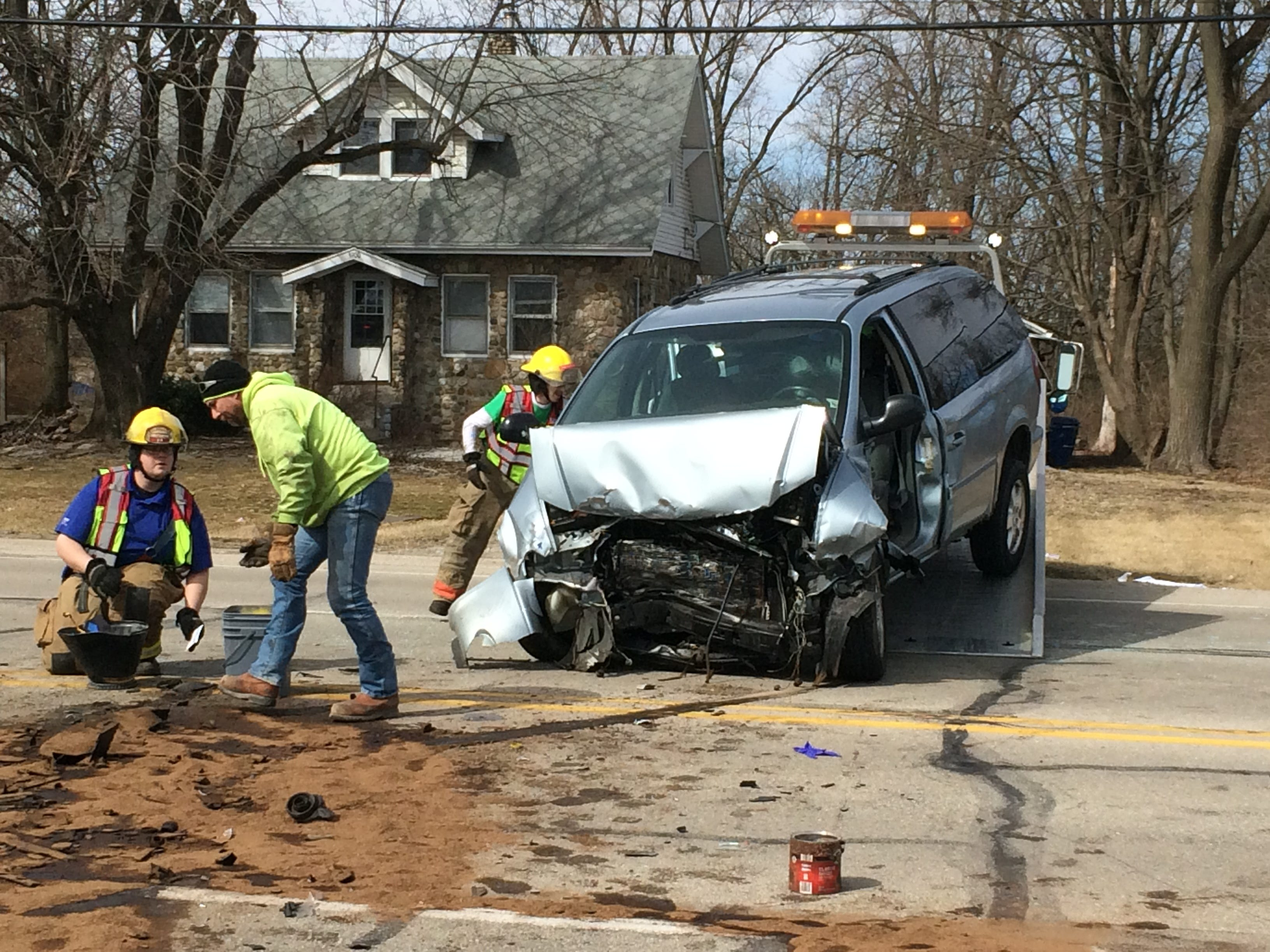 A Pardo's Towing & Recovery crew loads a Dodge Grand Caravan onto a wrecker after a Tuesday afternoon accident in the 3900 block of National Road West.