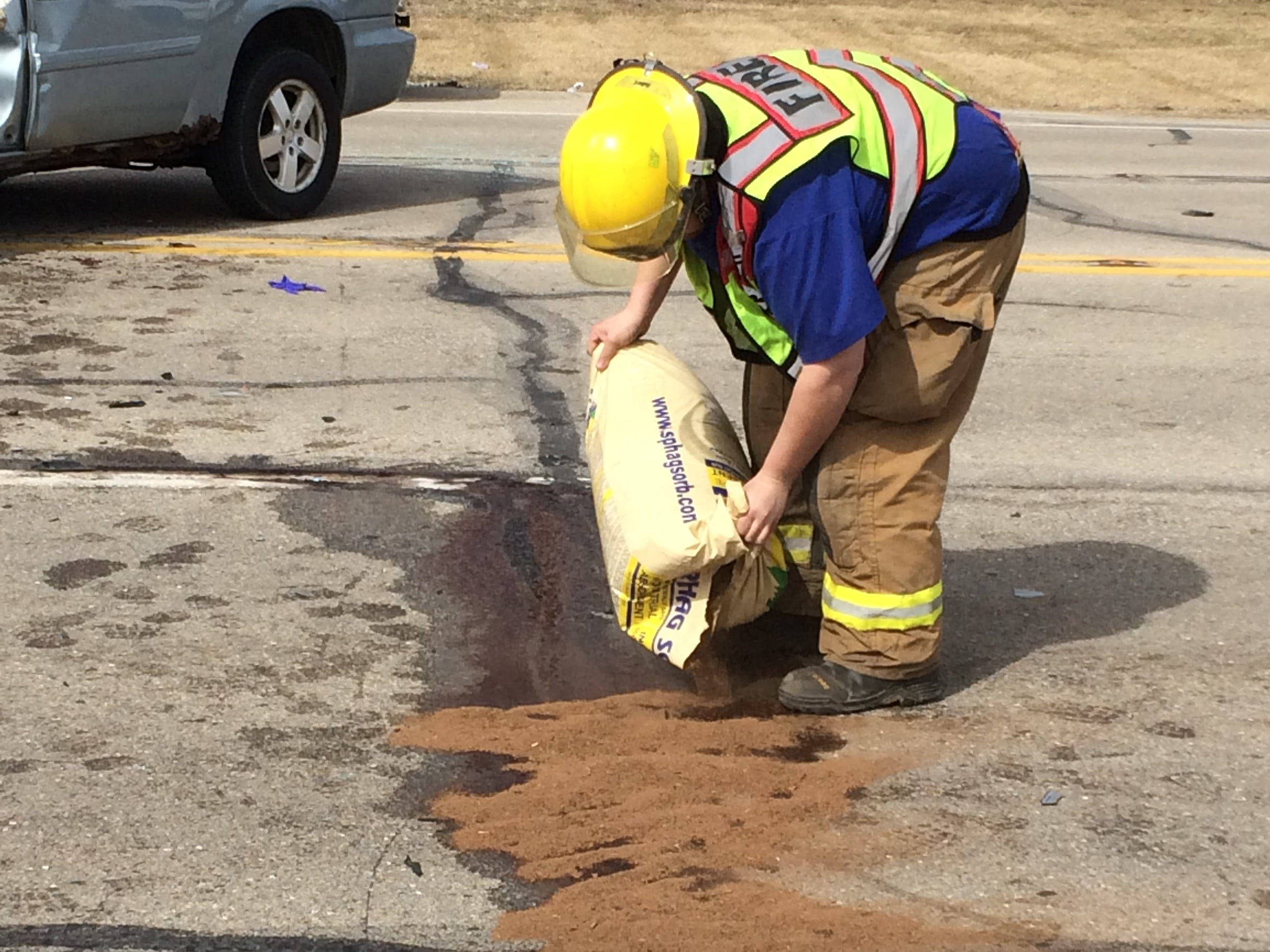 Centerville Fire/Rescue personnel cleaned up fluids in the roadway after a Tuesday afternoon accident in the 3900 block of National Road West.
