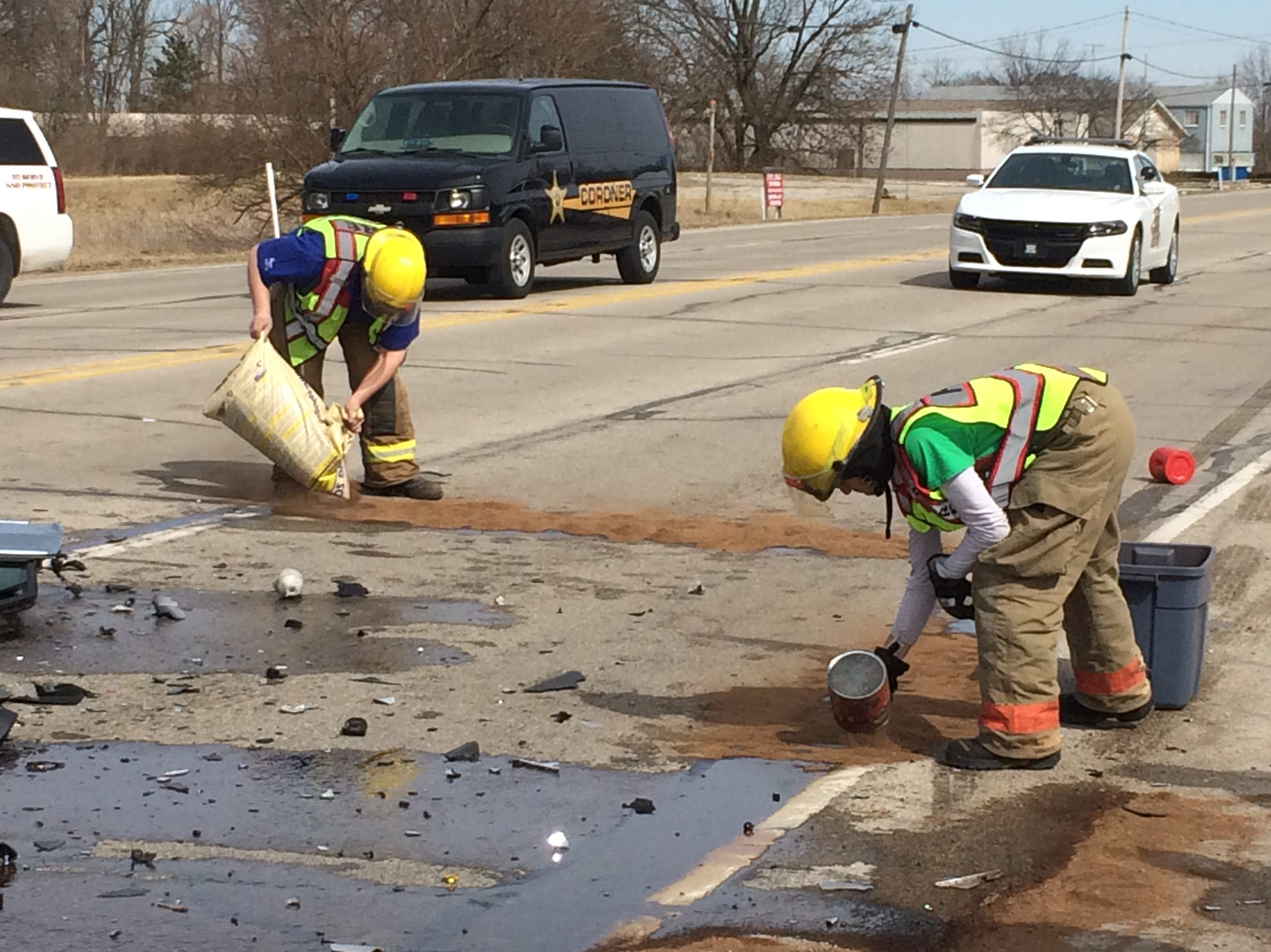 Centerville Fire/Rescue personnel put absorbent on fluids after a Tuesday afternoon accident in the 3900 block of National Road West.