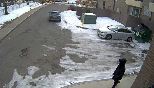 This image from a security camera shows Trevyan Rowe in the library driveway after leaving the bus loop at School 12, reportedly undetected.
