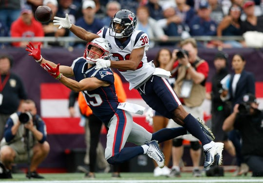 Kevin Johnson breaks up a pass intended for New England's Chris Hogan.
