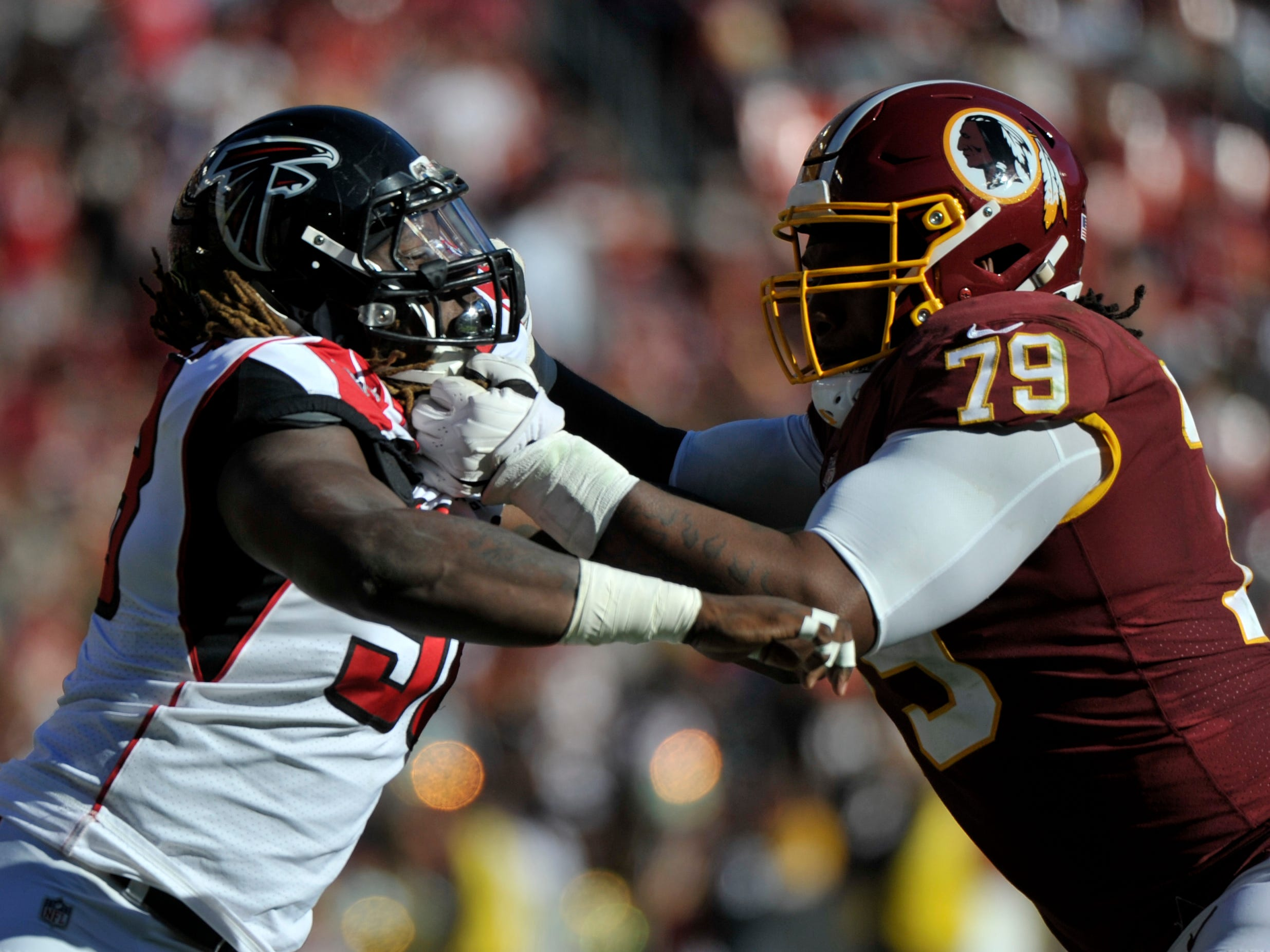 Atlanta Falcons defensive end Takkarist McKinley (left) rushes against Washington Redskins offensive tackle Ty Nsekhe (right) during an NFL football game between the Atlanta Falcons and Washington Redskins, Sunday, Nov. 4, 2018, in Landover, Maryland.