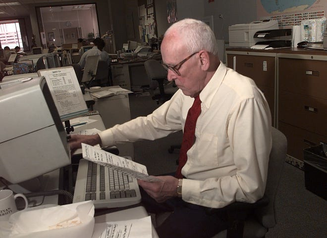 Dick Dougherty works in the Democrat and Chronicle's former newsroom on Exchange Boulevard on June 10 1998.