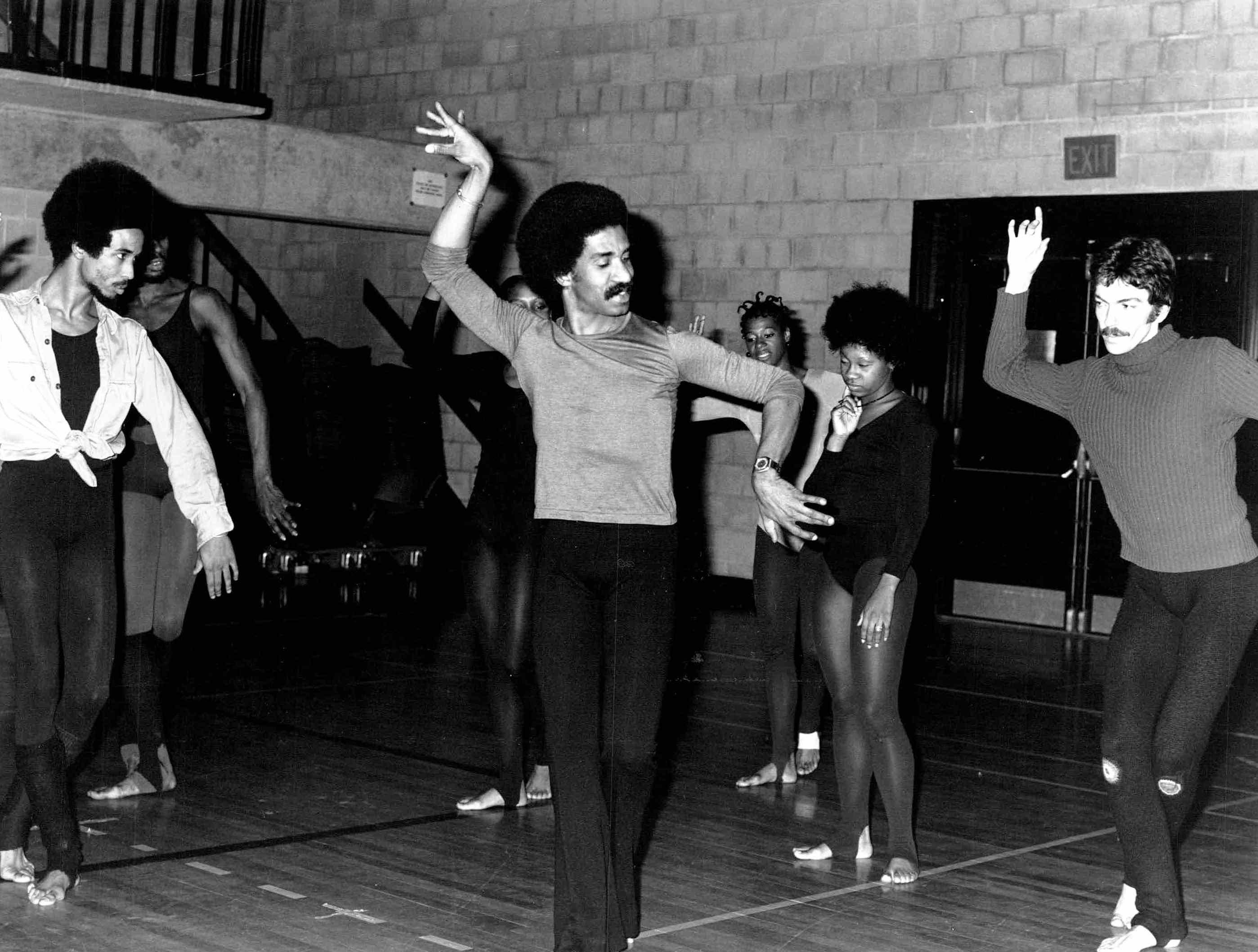 Garth Fagan demonstrates for dancers in this photo from 1974.