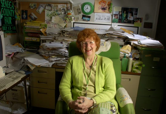 Longtime Democrat and Chronicle columnist Carol Ritter sits in April 2004 in her office, surrounded by her trademark green and piles of correspondence from readers. Ritter retired at the end of the month after 43 years as a reporter and columnist at the newspaper.