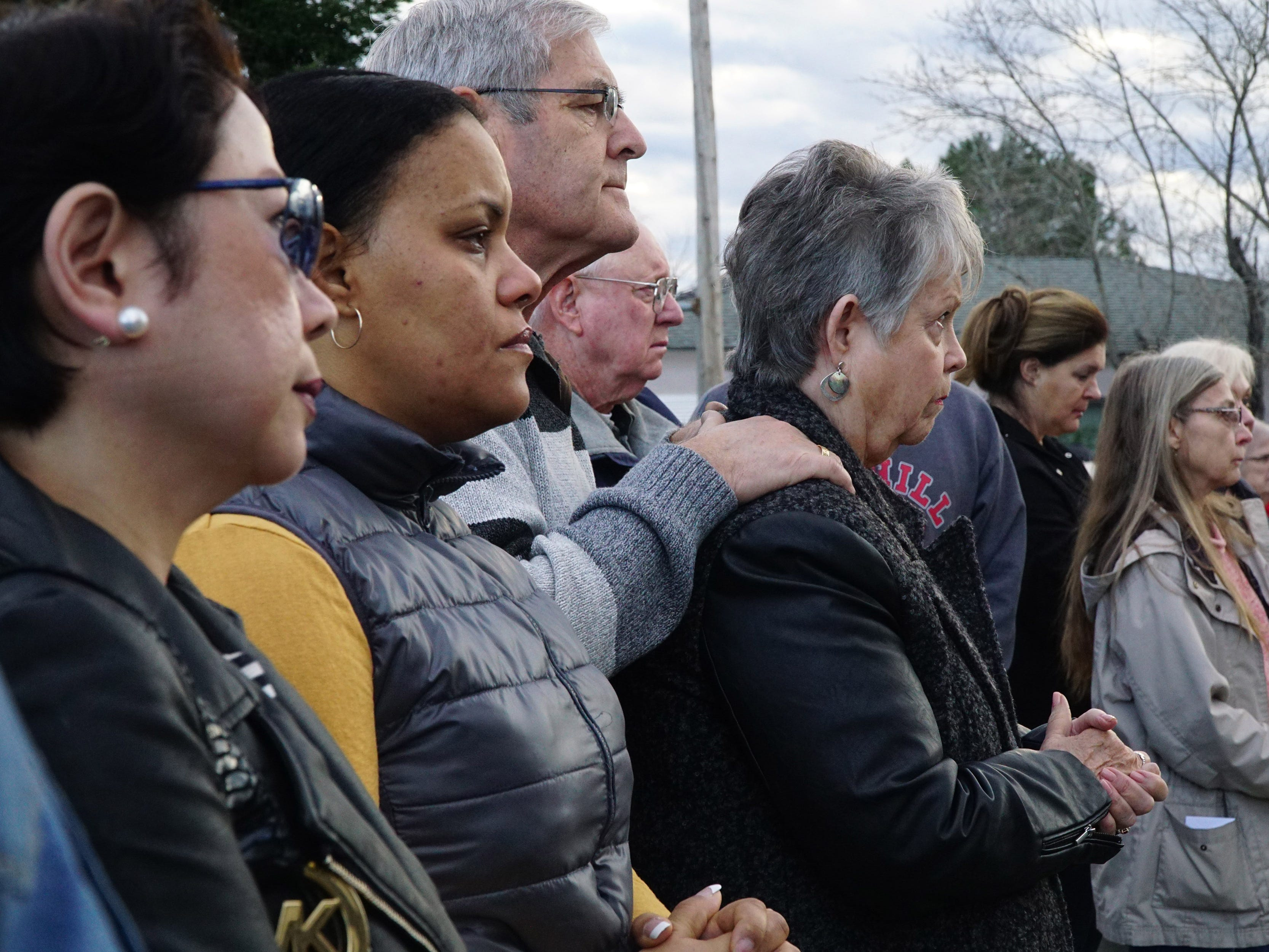 St. Joseph parishioners gather with family and friends of Melvin and Bennett Riffel for a memorial service on Tuesday morning, March 12, 2019 at the St. Joseph Church bell tower.  The Riffel brothers were among 157 people killed when an Ethiopian Airlines Boeing 737 crashed Sunday.