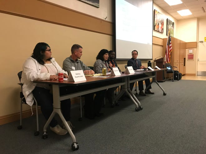 Monday's panel discussing foster and homeless youth included, from left to right, Mellisa Duarte-Love, Gary Vincent, Cheryl Camany, Darius Brown and Ernesto Vela.