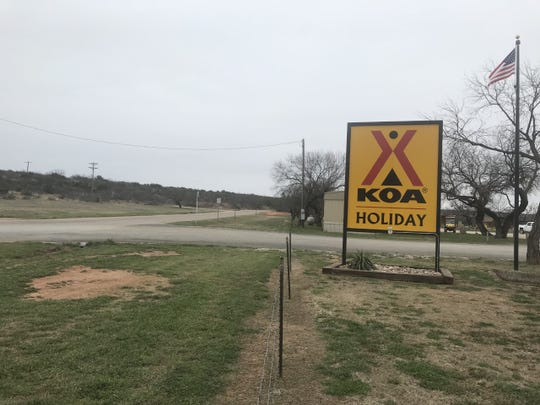 The KOA Holiday sign at 7400 Pine Grove Road near a two-mile loop.