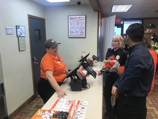 Officer Tracy Piatt-Fox ordering her first Whataburger meal Tuesday, March 12, 2019.