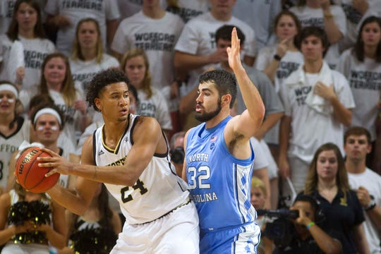 Nov 6, 2018; Spartanburg, SC, USA; Wofford Terriers forward Keve Aluma (24) is defended by North Carolina Tar Heels forward Luke Maye (32) during the second half at Richardson Indoor Stadium. Mandatory Credit: Joshua S. Kelly-USA TODAY Sports