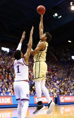 Dec 4, 2018; Lawrence, KS, USA; Wofford Terriers forward Keve Aluma (24) shoots over Kansas Jayhawks forward Dedric Lawson (1) in the first half at Allen Fieldhouse. Mandatory Credit: Jay Biggerstaff-USA TODAY Sports