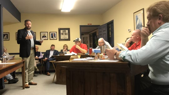 Curt Smith of the Accomack-Northampton Planning District Commission speaks about a grant application for a downtown revitalization project in Parksley, Virginia during a town council meeting on Monday, March 11, 2019.