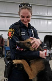 Sheboygan Police officer Anna Taylor hugs  police dog Max, Wednesday, March 6, 2019, in Sheboygan, Wis.