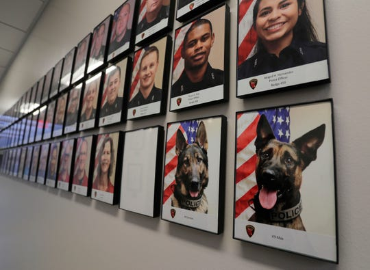 Grimm and Max are featured on the walls of the Sheboygan Police Department staffing portraits as seen, Wednesday, March 6, 2019, in Sheboygan, Wis.