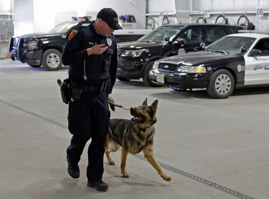 Sheboygan Police officer Matt Heimerl runs practice with police dog Grimm during a training session, Wednesday, March 6, 2019, in Sheboygan, Wis.
