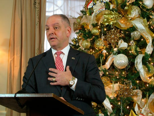 FILE - In this Dec. 20, 2018 file photo, Louisiana Gov. John Bel Edwards, a Democrat seeking re-election to a second term next year, answers questions from reporters at his end-of-the-year news conference in Baton Rouge. Edwards' push to give Louisiana public school teachers a pay raise and school districts their first spending increase in years has won support from the state's top school board.
