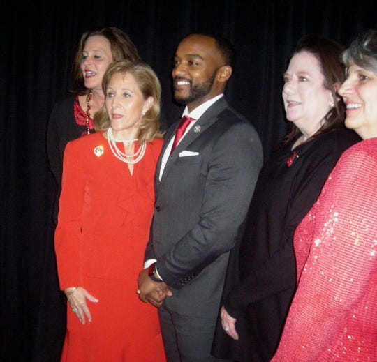 First Lady of Louisiana Donna Edwards and Shreveport Mayor Adrian Perkins (second and third from left) at Go Red for Women Luncheon at which Edwards was a special guest. Bossier City Mayor Lo Walker was also part of the lunch bunch.
