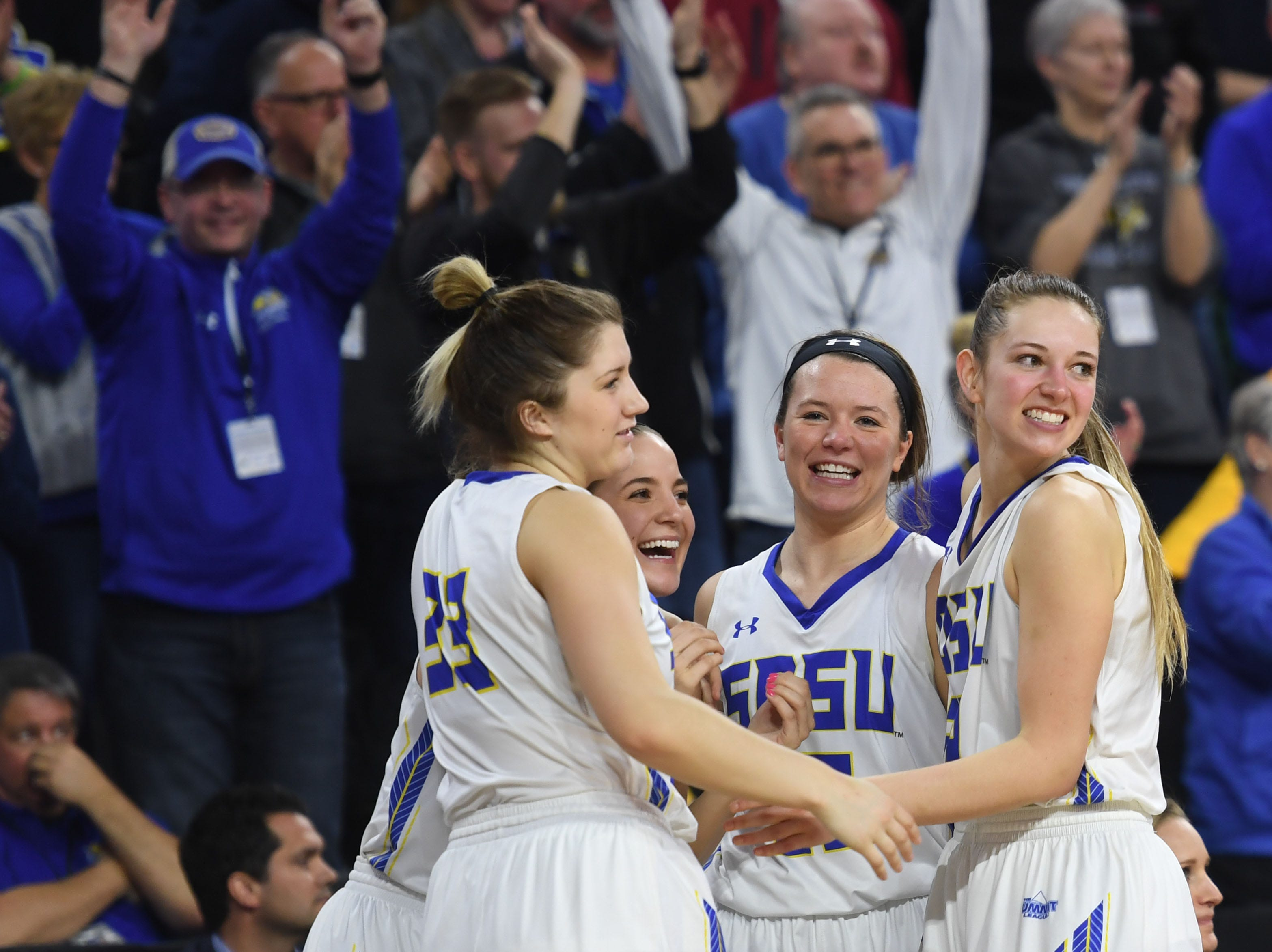 SDSU begins to celebrate in the final seconds of the game against USD Tuesday, March 12, in the Summit League women's championship at the Denny Sanford Premier Center in Sioux Falls.